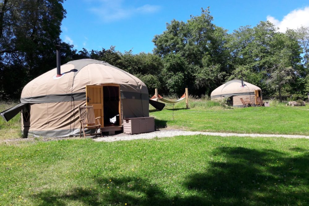 Two yurts with hammocks in between