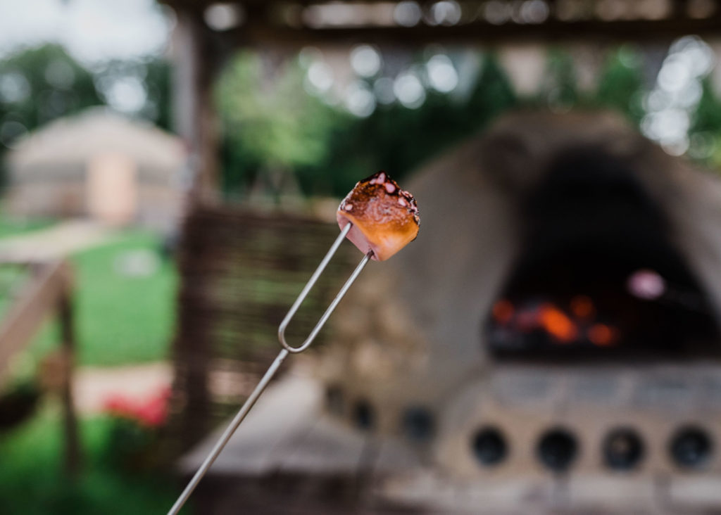 Toasted marshmallow with Pizza oven behind