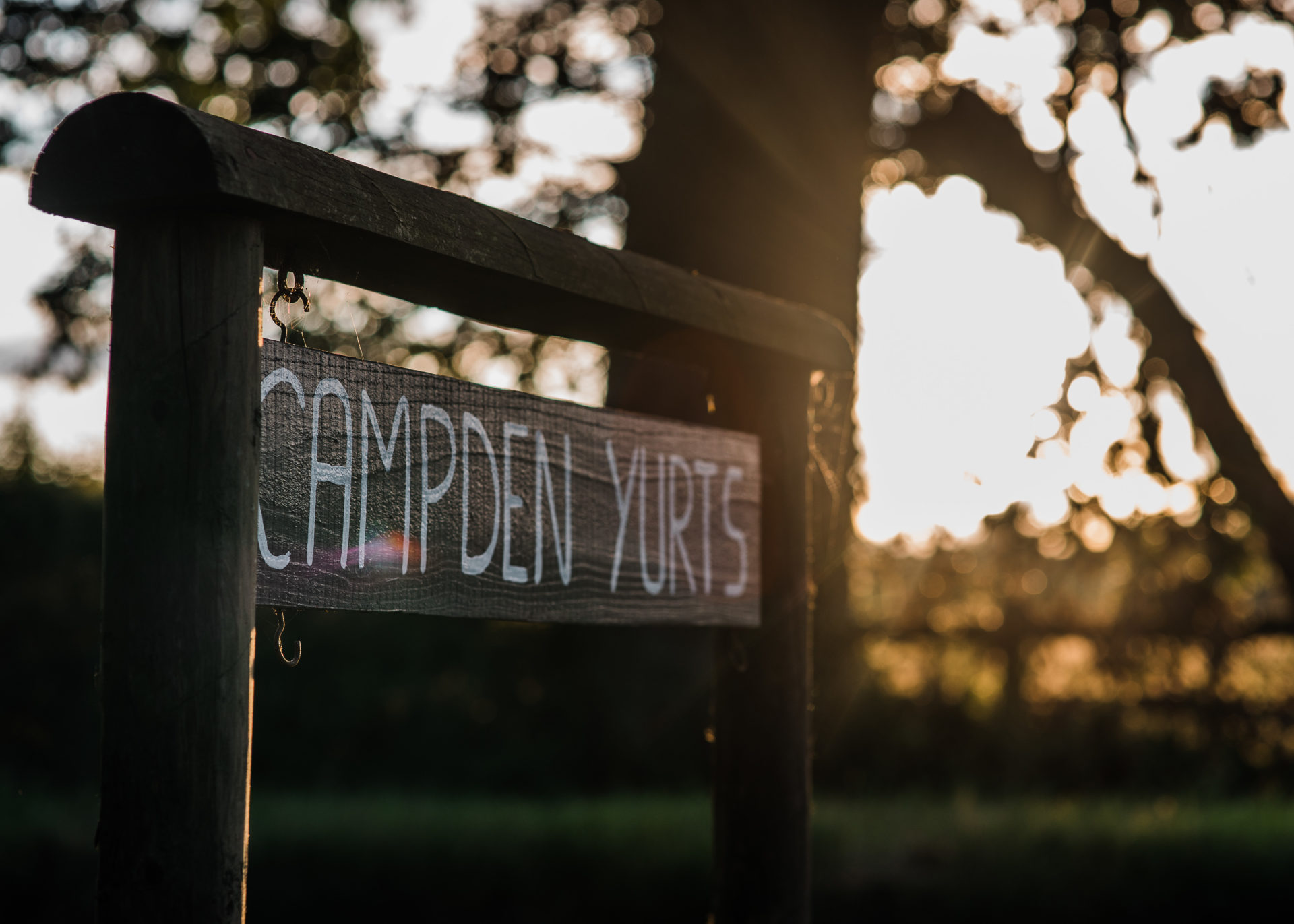 Wooden sign of Campden Yurts