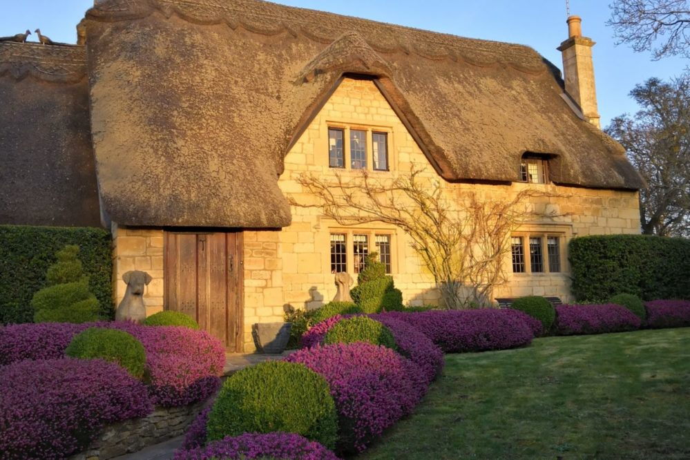 A thatched Cotswold stone cottage