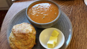 Bowl of soup and cheese scone
