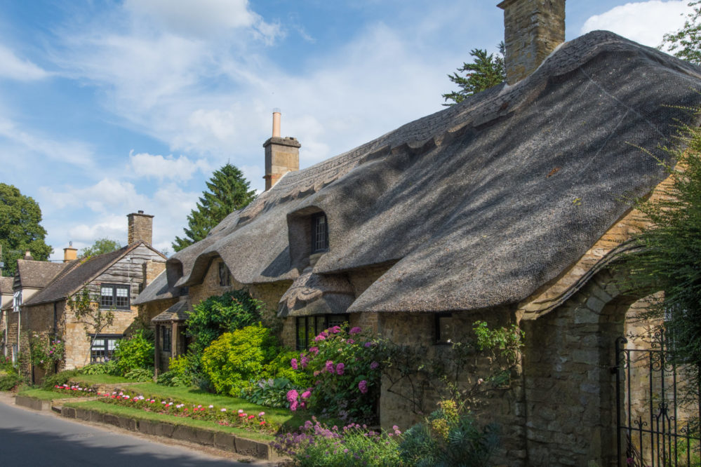 Pretty thatched Cotswold stone cottage