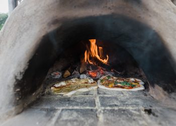 Pizzas cooking in the pizza oven