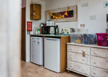 Utility room with fridges, kettle, microwave and toaster