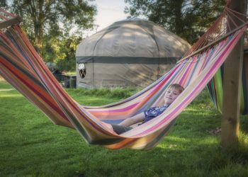 Relax in a hammock near to the yurts